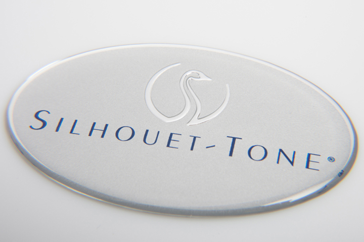 Badge - a plat - domage - Silhouet-tone